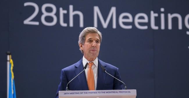 Before Syria talks, Kerry visits Rwanda's genocide memorial