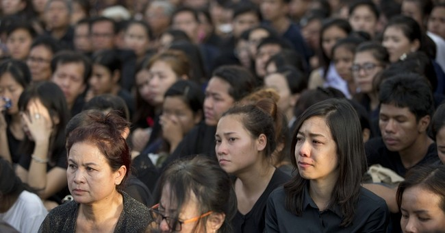 The Latest: Thais grieve for late king as a beloved father