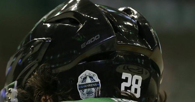 Stars honor slain Dallas officers before, during NHL opener