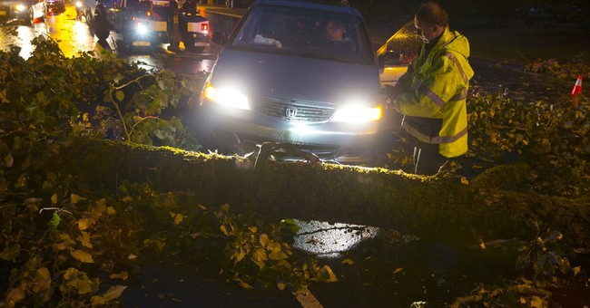 The Latest: Motorists told to stay off flooded roads