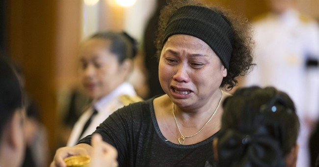 In  wake of Thai king's death, grief is black and white