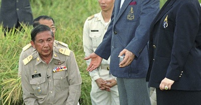 Glimpses behind the exalted persona of Thailand's king