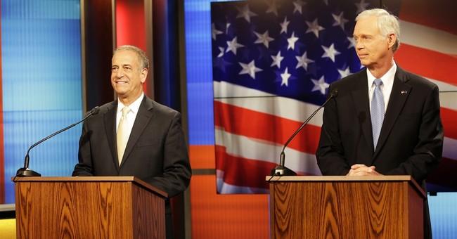 Wisconsin Sen. Ron Johnson stands by Trump in debate