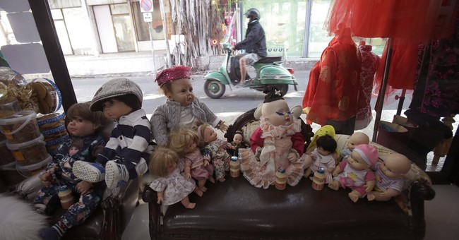 In latest fad, Thais treat 'child angel' dolls like pets