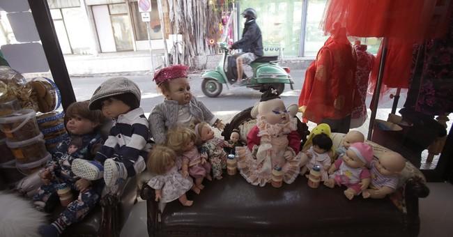 In latest fad, Thais treat 'child angel' dolls like pets
