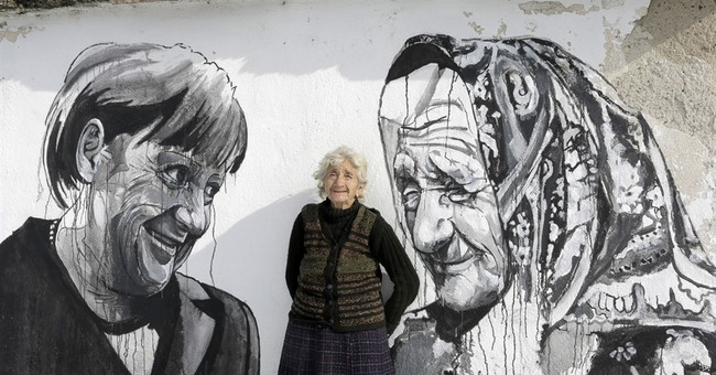 AP PHOTOS: Bulgarian town hopes murals bring in the tourists
