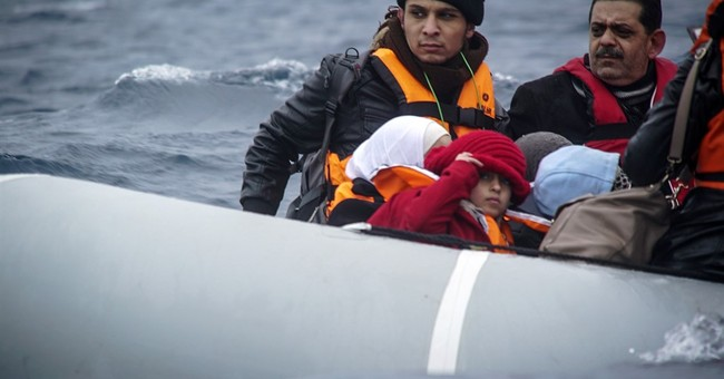 The Latest: Merkel says many refugees will return home