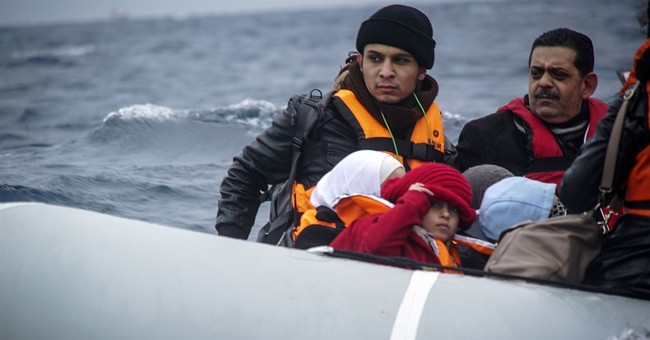 The Latest: Italy questions giving migrant aid to Turkey