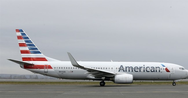 American Airlines posts record profit for 4Q, all of 2015