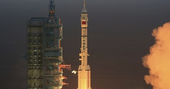 China launches manned mission to experimental space station
