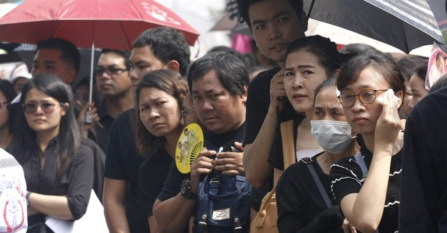 Grief after Thai king's death spills into anger
