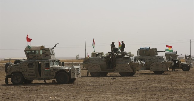 The Latest: More than 100 US troops with Iraqi forces