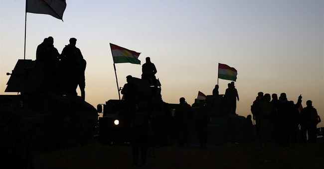 AP PHOTOS: Iraqi forces march on Mosul