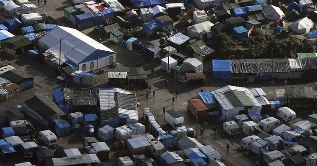 From air, few signs of French migrant camp's imminent end