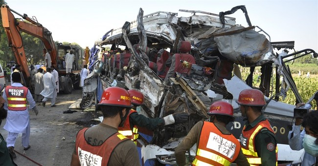 Buses collide head-on in central Pakistan, killing 25 people