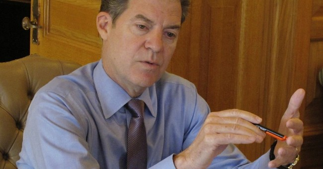 Kansas Gov. Brownback wary of tax hike but won't rule it out