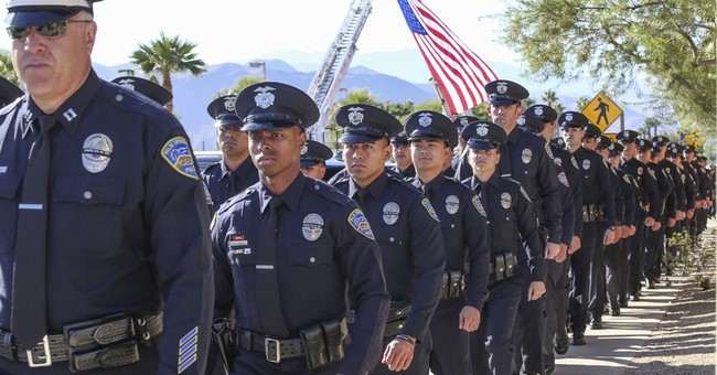 The Latest: Family recalls example set by slain officer