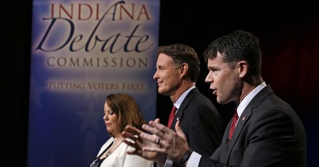 Bayh, Young keep up biting attacks during Senate debate
