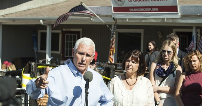 Pence visits firebombed office, defends 'rigged' claims
