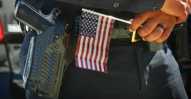 2 slain California police officers remembered at memorial