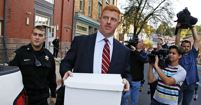 The Latest: Ex-coach recalls hearing of Sandusky complaint