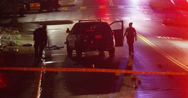 The Latest: Officers called incident with gunman an ambush
