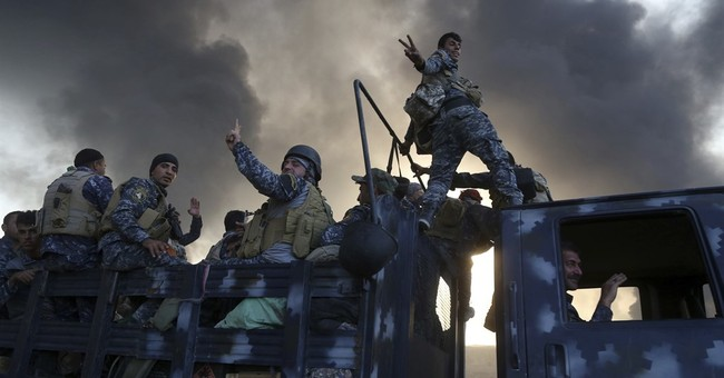 The Latest: Save the Children says 5,000 fled Mosul area