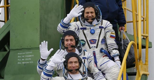 Soyuz rocket carrying crew of 3 blasts off from Baikonur
