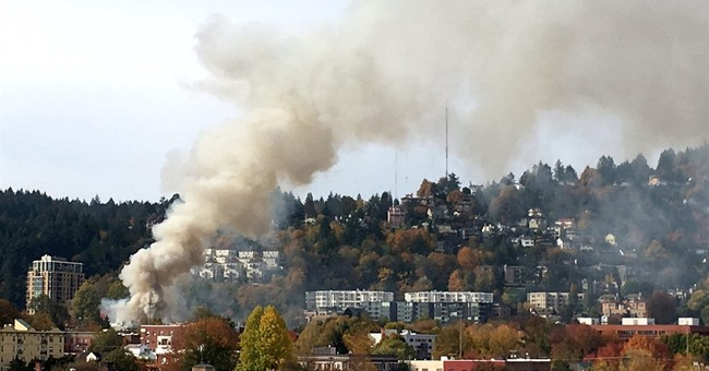 The Latest: Firefighter thrown 20 feet by gas explosion