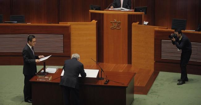Pro-Beijing side thwarts new Hong Kong lawmakers' oath redo