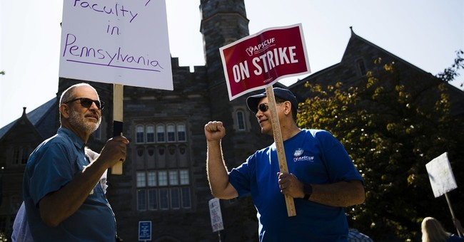 Professors strike a second day, disrupting 100,000 students