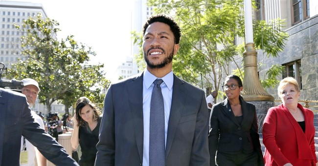 NBA's Derrick Rose cleared in rape lawsuit, poses with jury