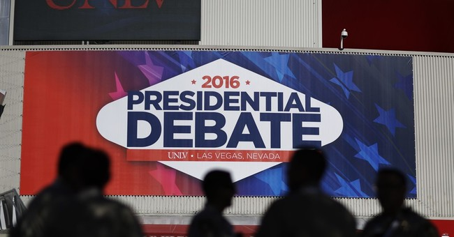 Outside Las Vegas debate arena, a buzz of bands, protests