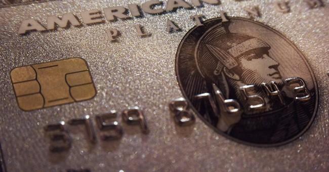 American Express profit falls 10 percent, but tops estimates