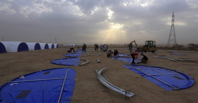 Iraqi town outside Mosul rises up against militants