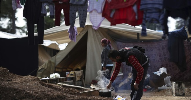 The Latest: French minister says Calais camp closure near