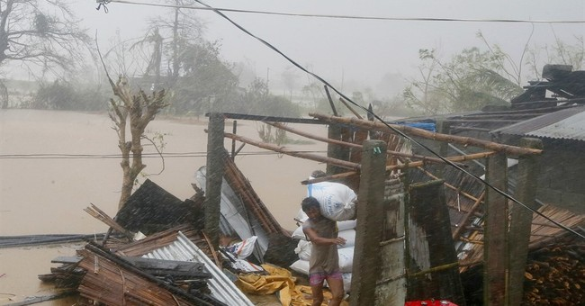 Typhoon Haima leaves at least 7 dead in northern Philippines