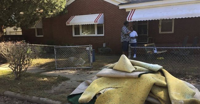 Flood victims face major challenges as early voting begins