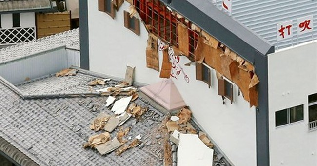 Strong quake in western Japan knocks out power, injures 7