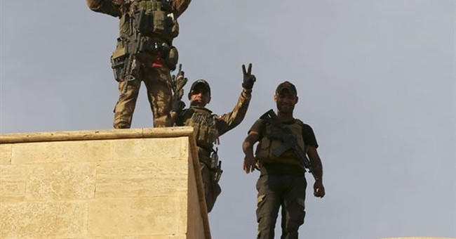 Under fire in Mosul, IS attacks another Iraqi city