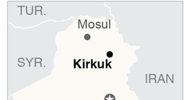 The Latest: Iraqis raise flag over church in town near Mosul