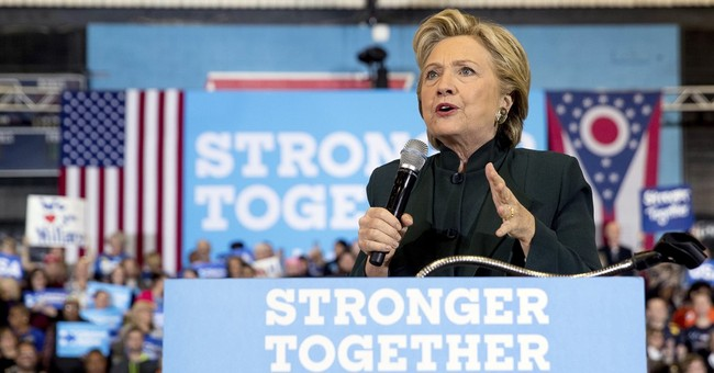Victory in sight, Clinton still grapples with negative views