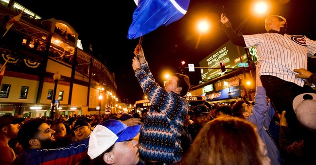 The Latest: President Obama, White Sox fan, cheers on Cubs
