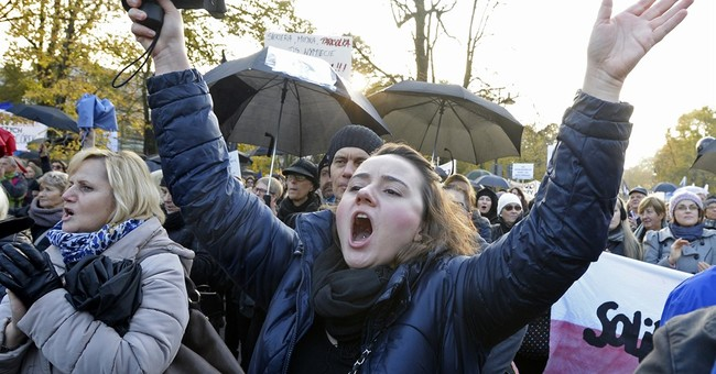 Poles stage new protests over proposed abortion restrictions