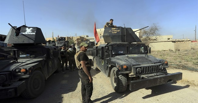 The Latest: Turkish says its artillery aiding Iraq Kurds