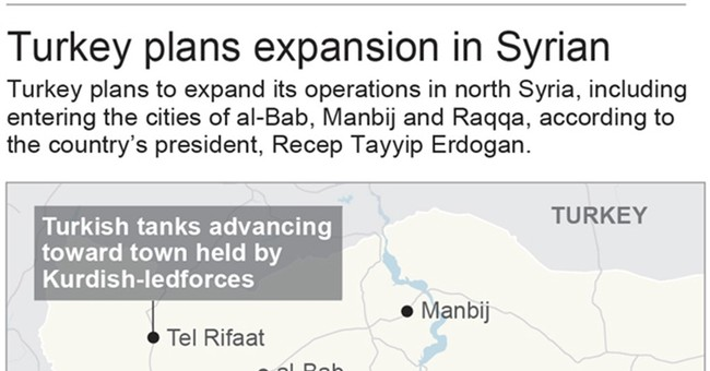 The Latest: Aid convoy reaches Damascus suburb