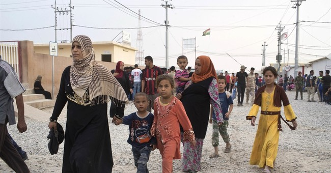 The Latest: Iraq PM offers new details of assault on town