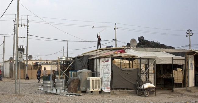 Iraqis on edge of Mosul face a deadly dilemma: Stay or flee