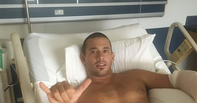 Surfer bitten by shark at beach; says 'came out of nowhere'