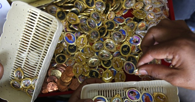 Image of Asia: Selecting lockets to honor late Thai king